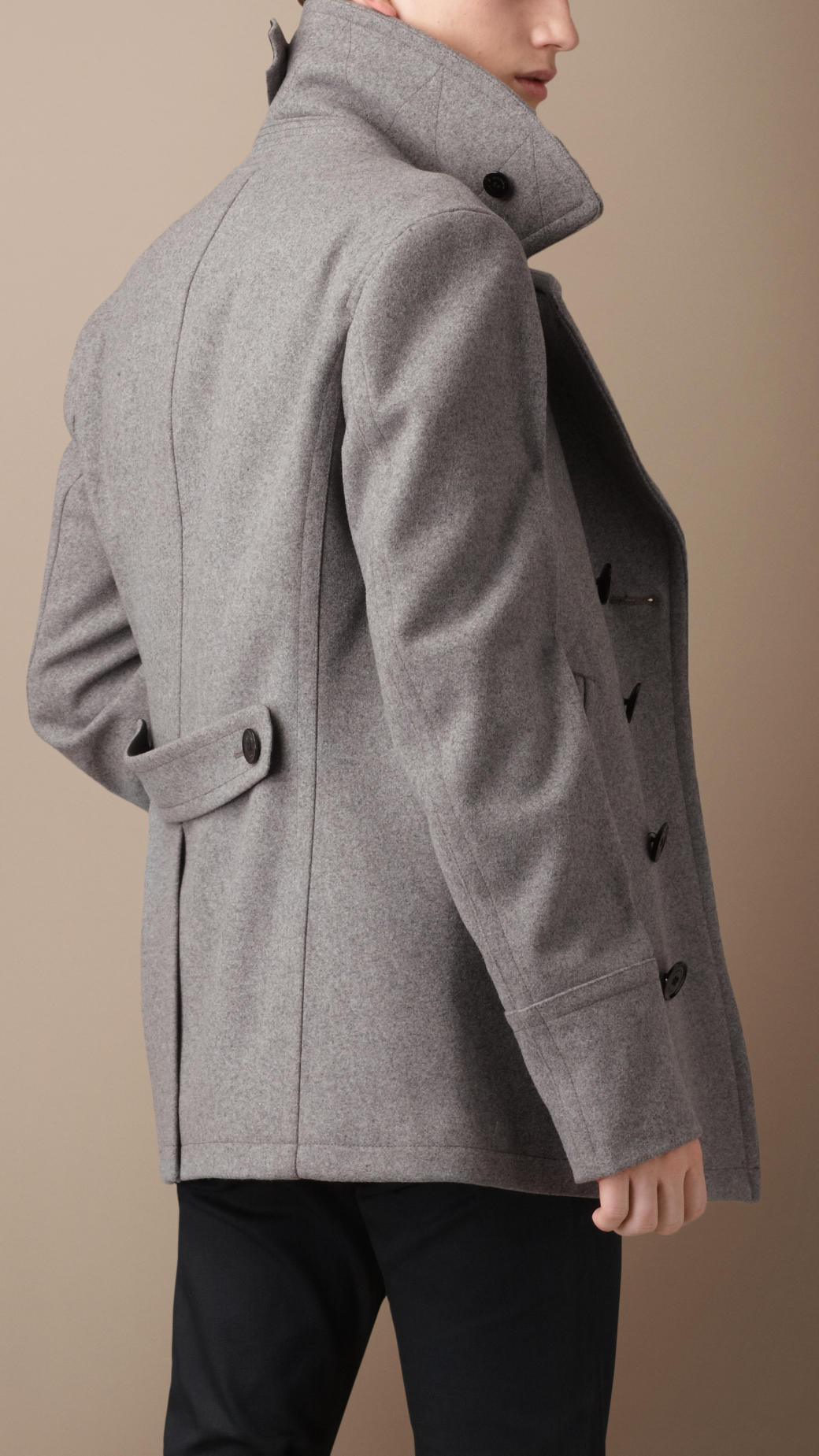 Try a gray wool overcoat from Lauren Ralph Lauren, or a charcoal style by Kenneth Cole finished in notched lapels and a sharp gray herringbone. A sharp heather-hued wool car coat from MICHAEL Michael Kors is a sophisticated way to stay warm in your suit and oxfords.