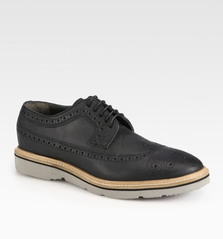 orange casual wingtip laceup in black for lyst
