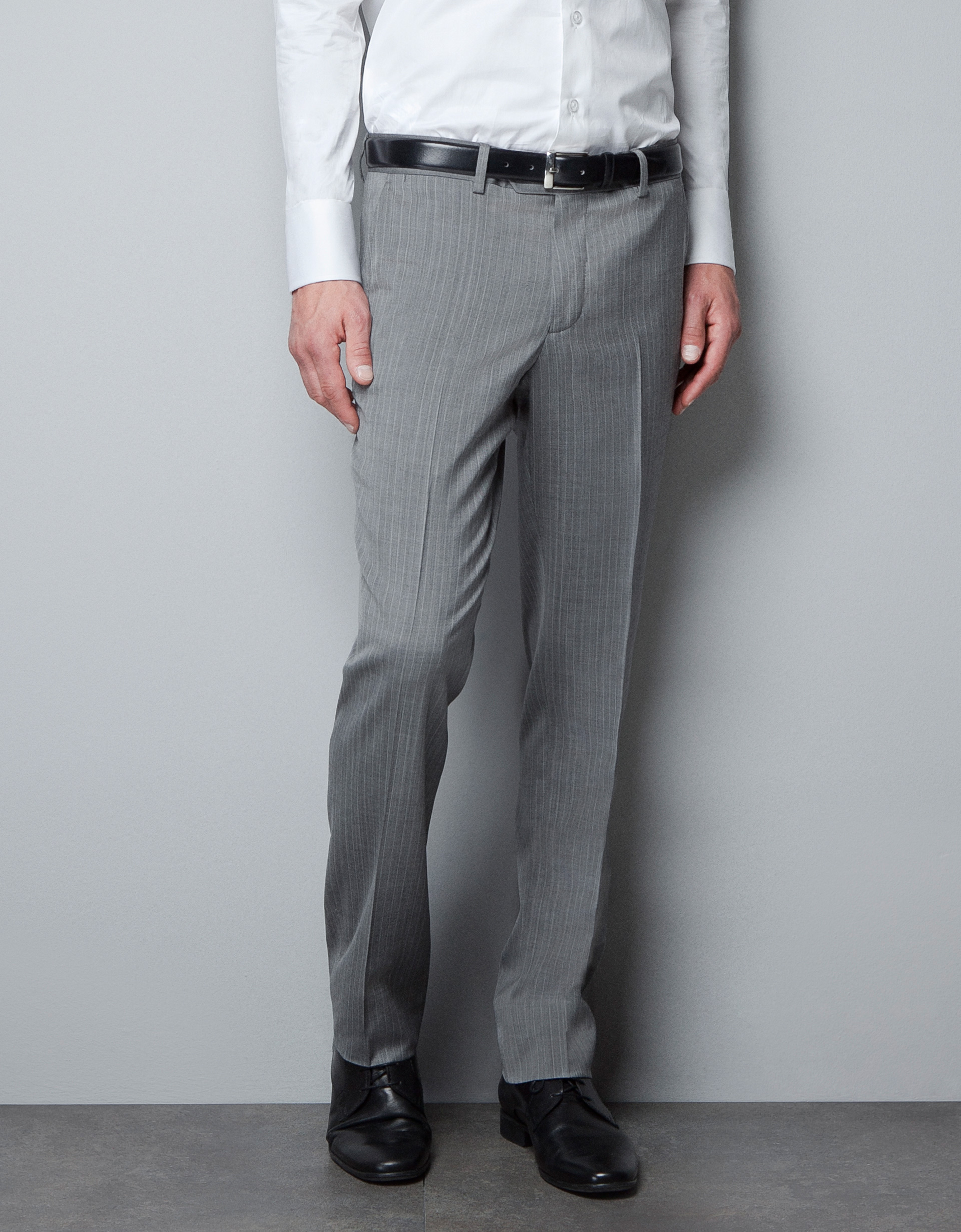 Grey flannel trousers match almost any color and pattern. There is no color or pattern of shirt, tie, or jacket with which it clashes. You could blindly pick any combination to go with your grey flannel trousers and rest assured that it will work.