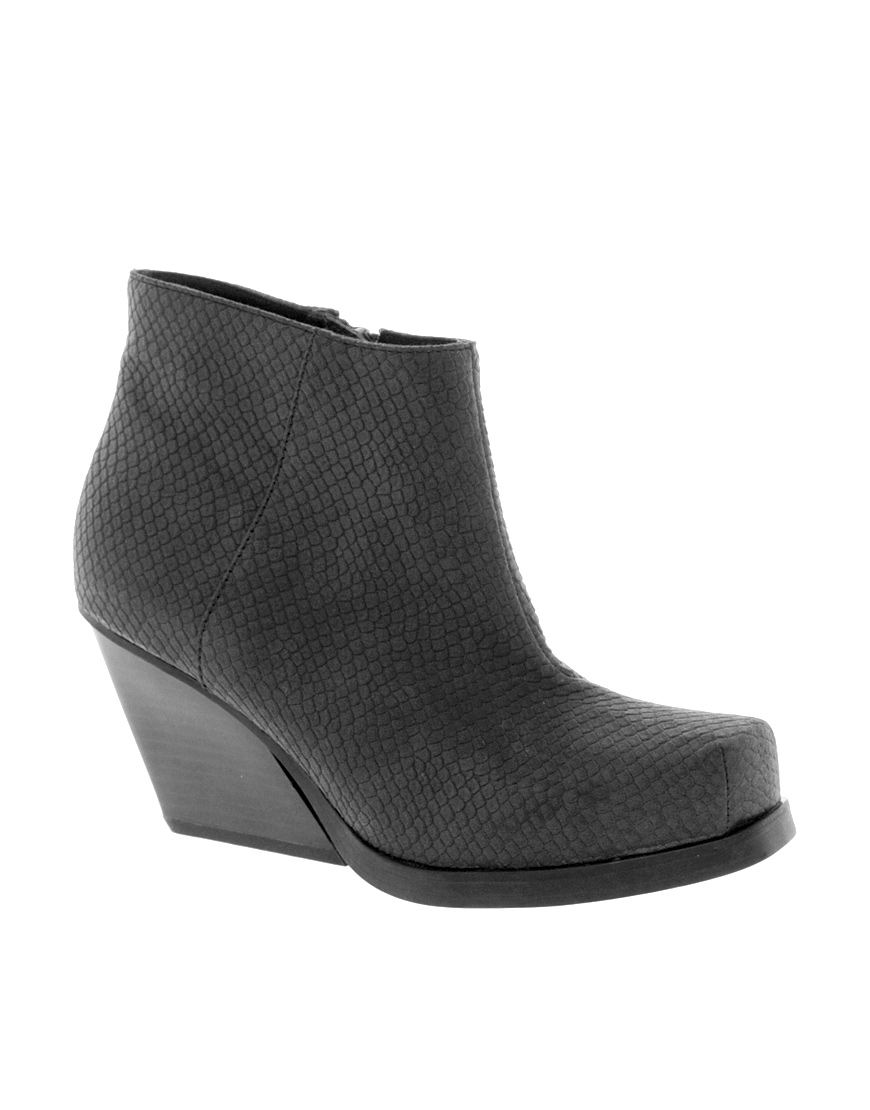 cheap monday angle low snake ankle boots in black lyst