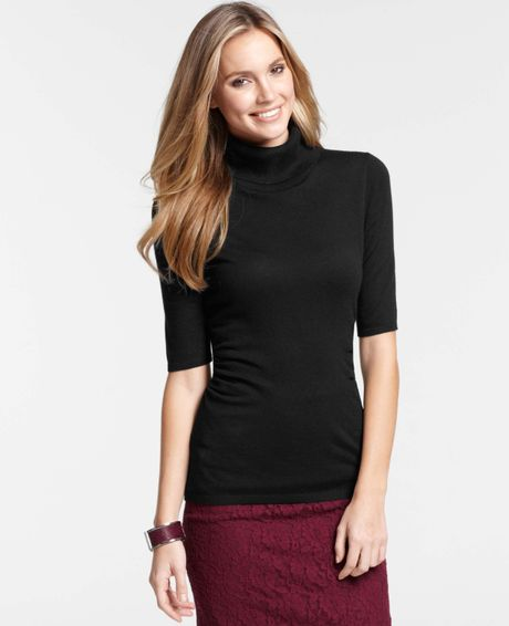 Theory's Elizabeth Turtleneck is a timeless wardrobe staple, sleek and definitely chic. This short sleeve top has a turtleneck and a light feel that's just right for layering.