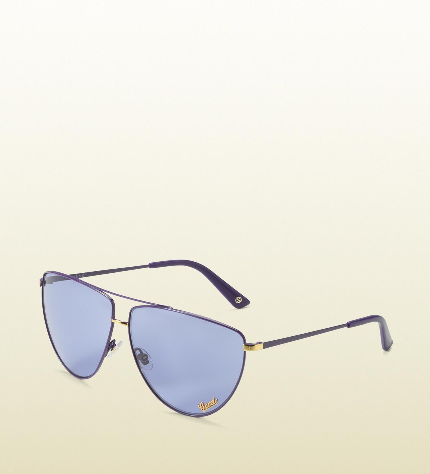 26de3eea14a Lyst - Gucci Medium Oval Frame Sunglasses with Gucci Script Plaque ...
