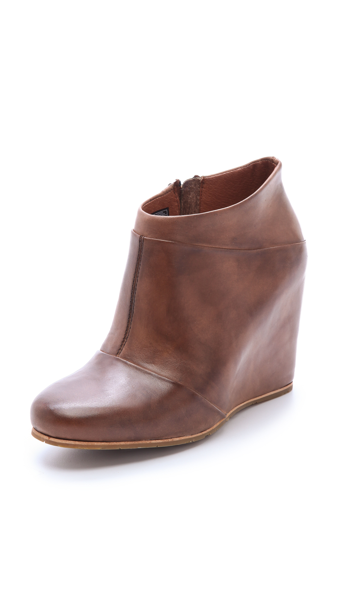 A women's pair of UGG Australia Lou black leather and suede boots in size 8. These boots feature black leather to the toes and heel counters and suede shafts with .