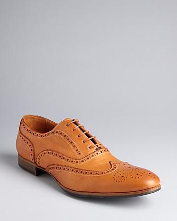 Tan wingtip dress shoes