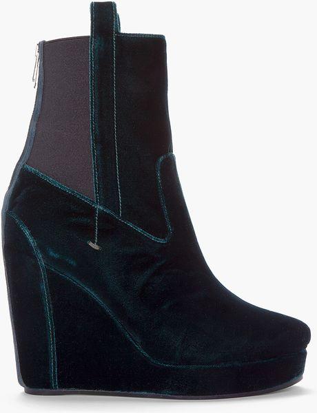 bruno emerald green velvet wedge boots in green