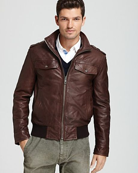 http://cdnd.lystit.com/photos/2012/10/03/andrew-marc-dark-brown-amp-stand-collar-bomber-jacket-product-1-4874908-940980992_large_flex.jpeg