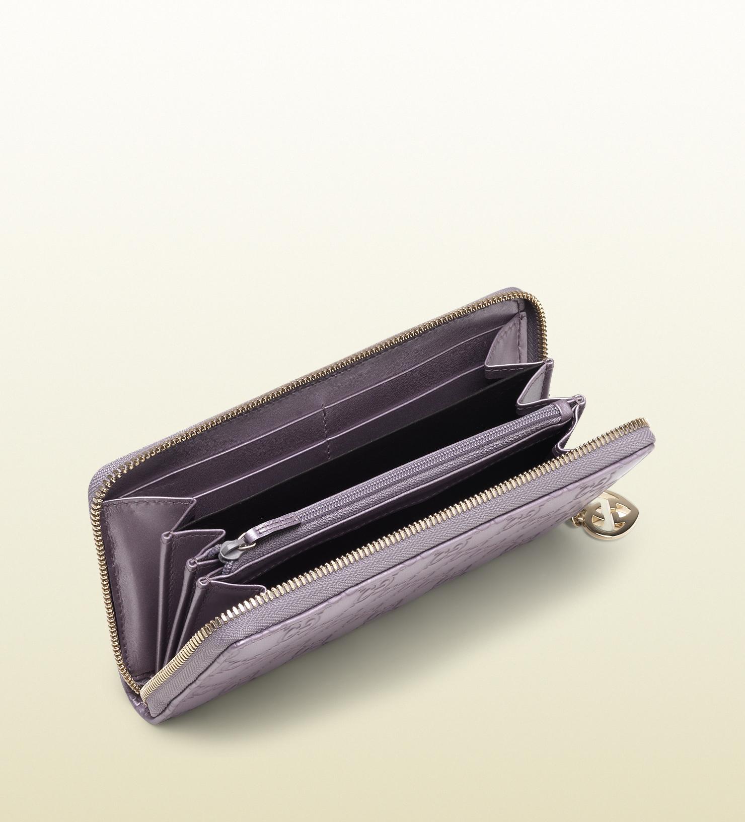b69e4f8c7cc9 Gucci Lila Metallic Guccissima Leather Zip Around Wallet in Purple ...