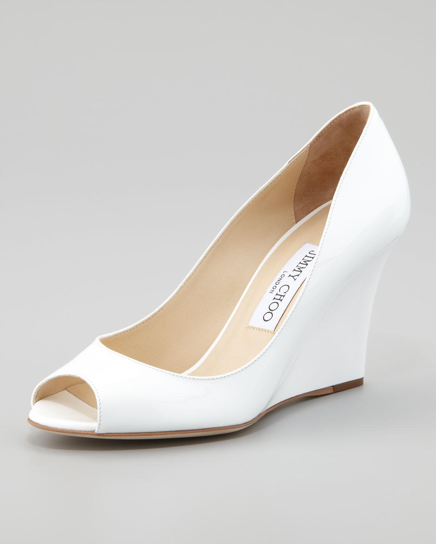 b217a37784e Lyst - Jimmy Choo Baxen Peeptoe Patent Wedge White in White
