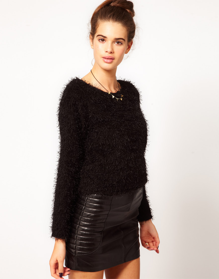 A black fluffy jumper featuring in a bardot style. Regular fit. 68% polyester 32% acrylic. Approx length: 52cm/