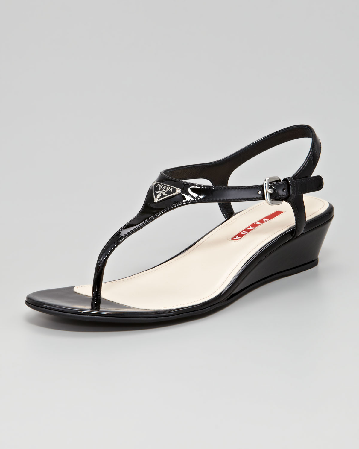6a0ebf003084 Lyst - Prada Patent Logo Demi Wedge Sandal in Black