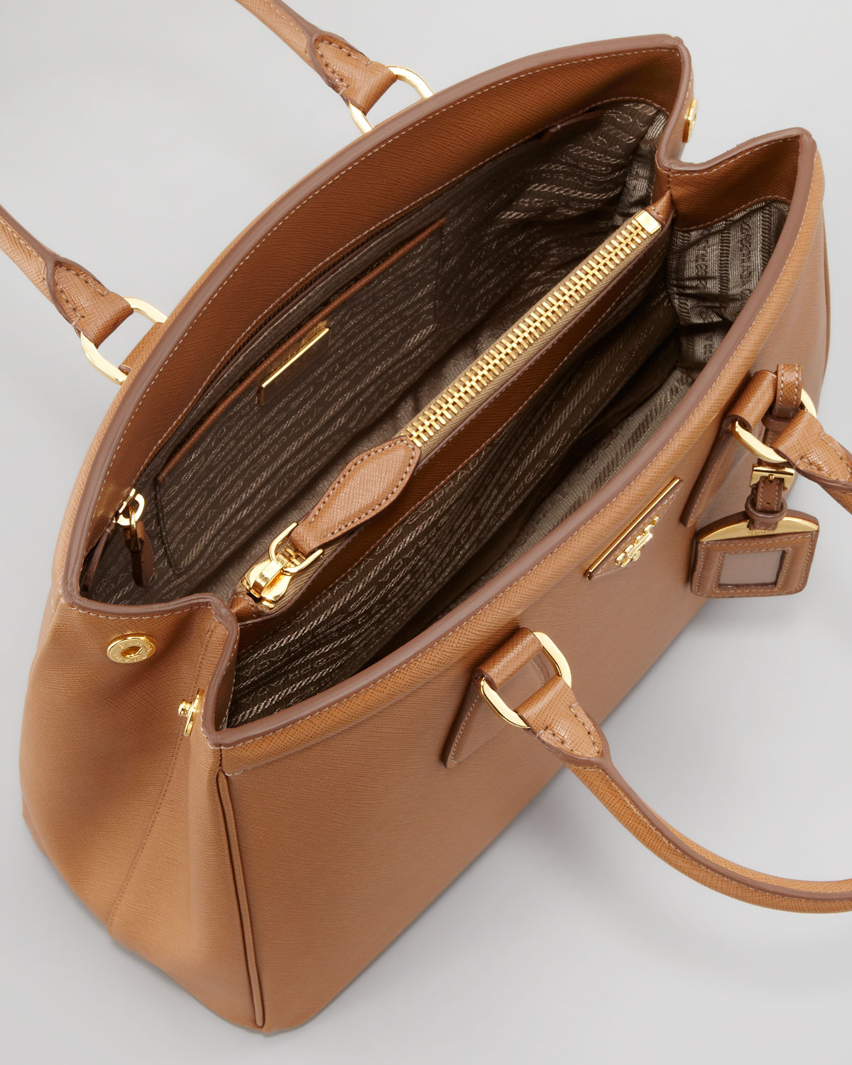 56a7fcaf78d2 where can i buy prada saffiano parabole bag caramel in brown caramel lyst  prada galleria bag