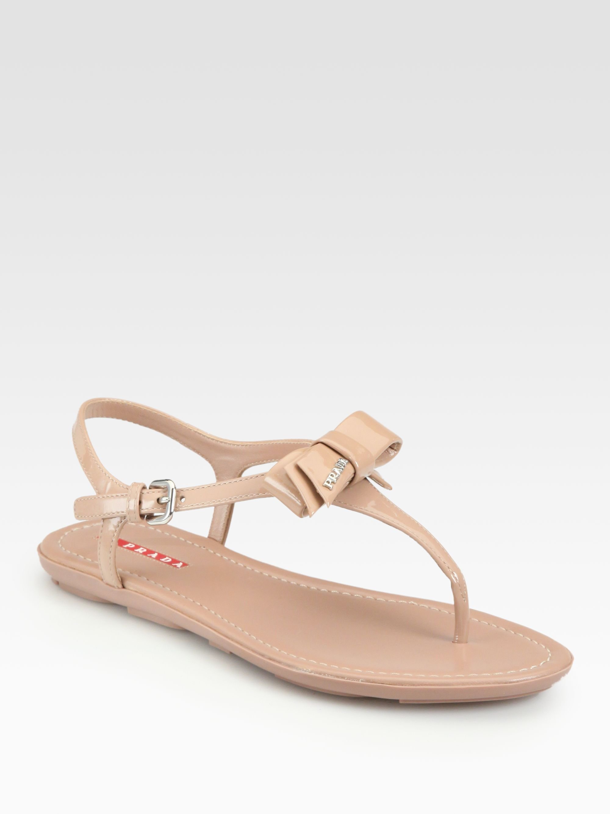 c6f6cfe27 Lyst - Prada Patent Leather Bow Thong Sandals in Natural