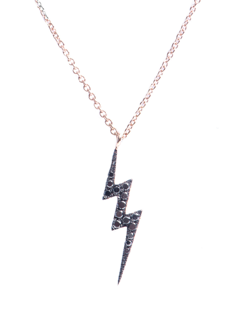 diane kordas and gold lightning bolt necklace in