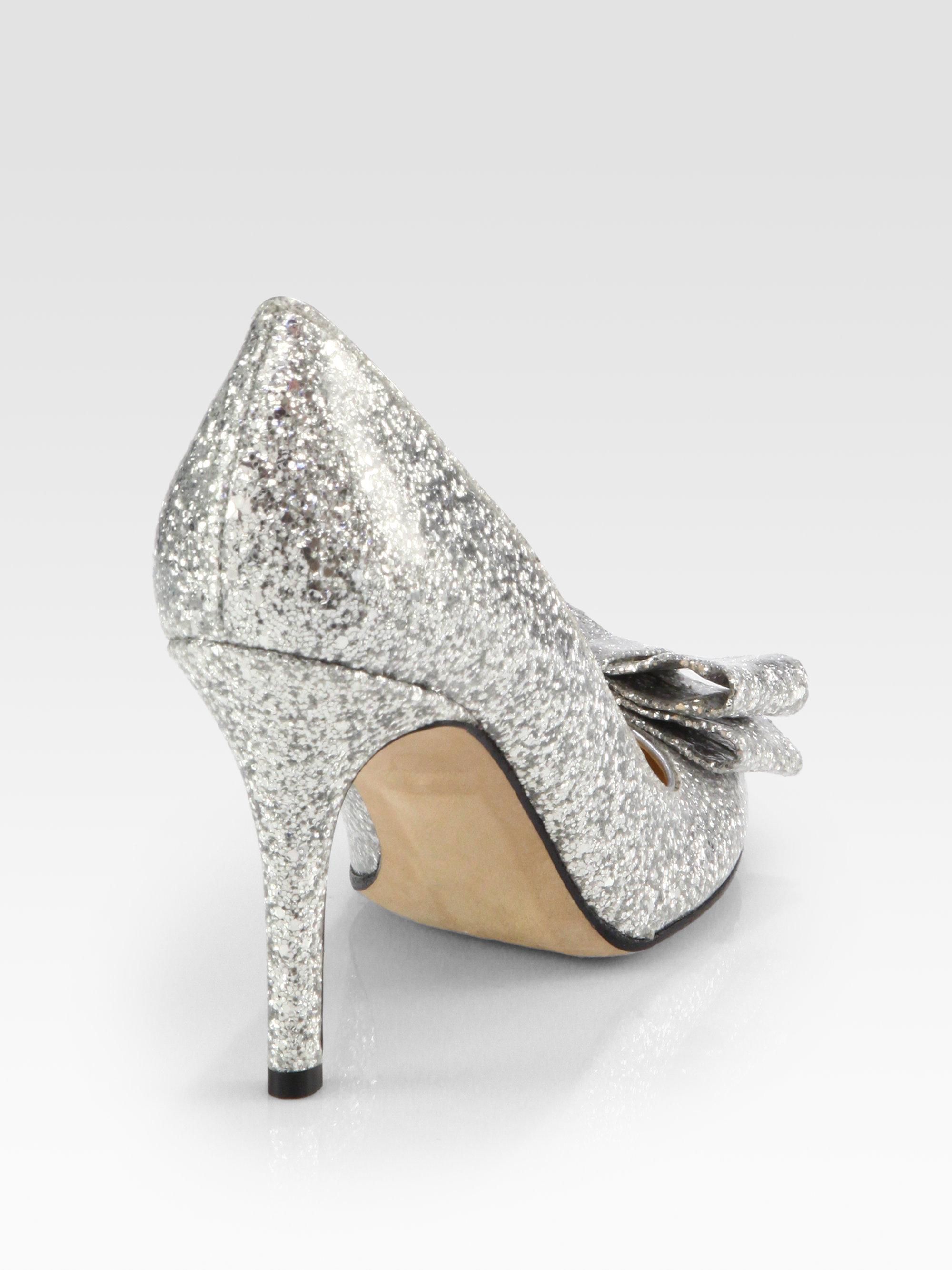 8d14b5cf6eb Lyst - Kate Spade Krysta Glittercoated Patent Leather Bow Pumps in ...