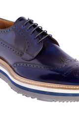 Prada Stacked Sole Perforated Wingtip Blucher - Lyst