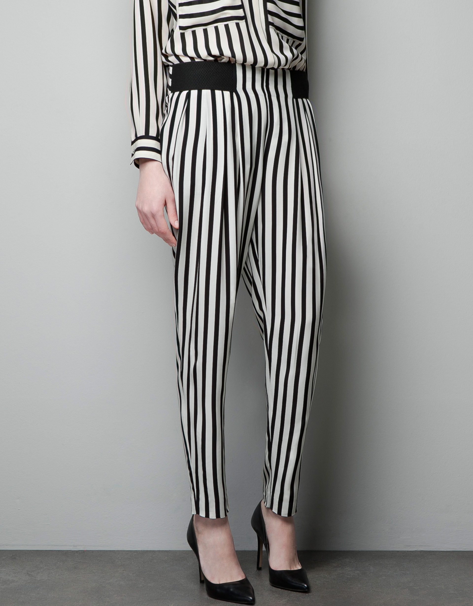 Give your officewear an update with black and white stripe trousers, available in tapered to tie-waist styles. With options that take your outfit from day to night, find your favourites from striped wide leg trousers to side stripe joggers and striped culottes.
