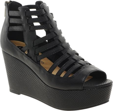 ed9b41c11636 River Island Strappy Caged Flatform Sandals in Black