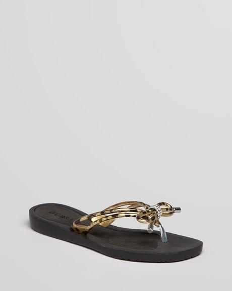 09f7c83e37e23 Guess Flip Flops Talya Bow in Black (leopard)