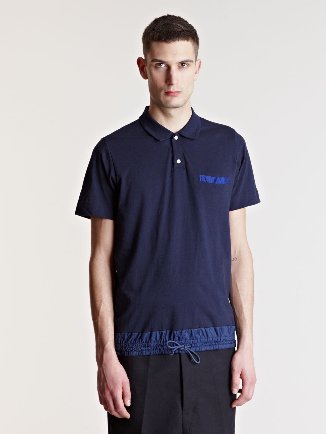 Sacai polo shirt in blue for men lyst Man in polo shirt