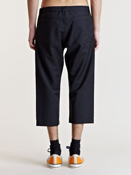 High-waters are no longer an accident caused by bad tailoring or a late growth spurt. This season's cropped pants are not only intentional—they are very, very cool. Thom Browne, OG of the short pant trend, is still at it. And the look's extended to brands young and .