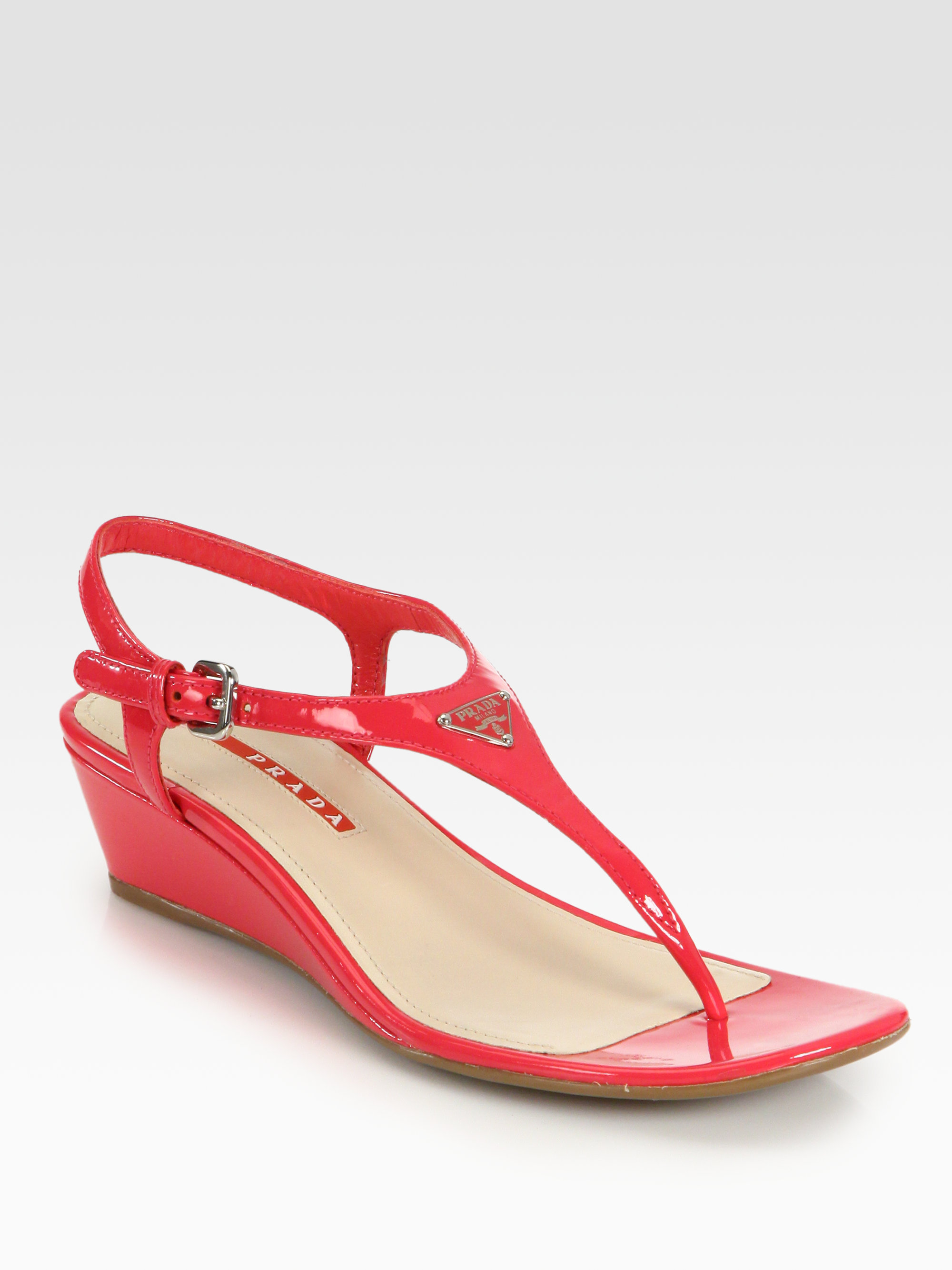 43716e044 Lyst - Prada Patent Leather Thong Wedge Sandals in Red