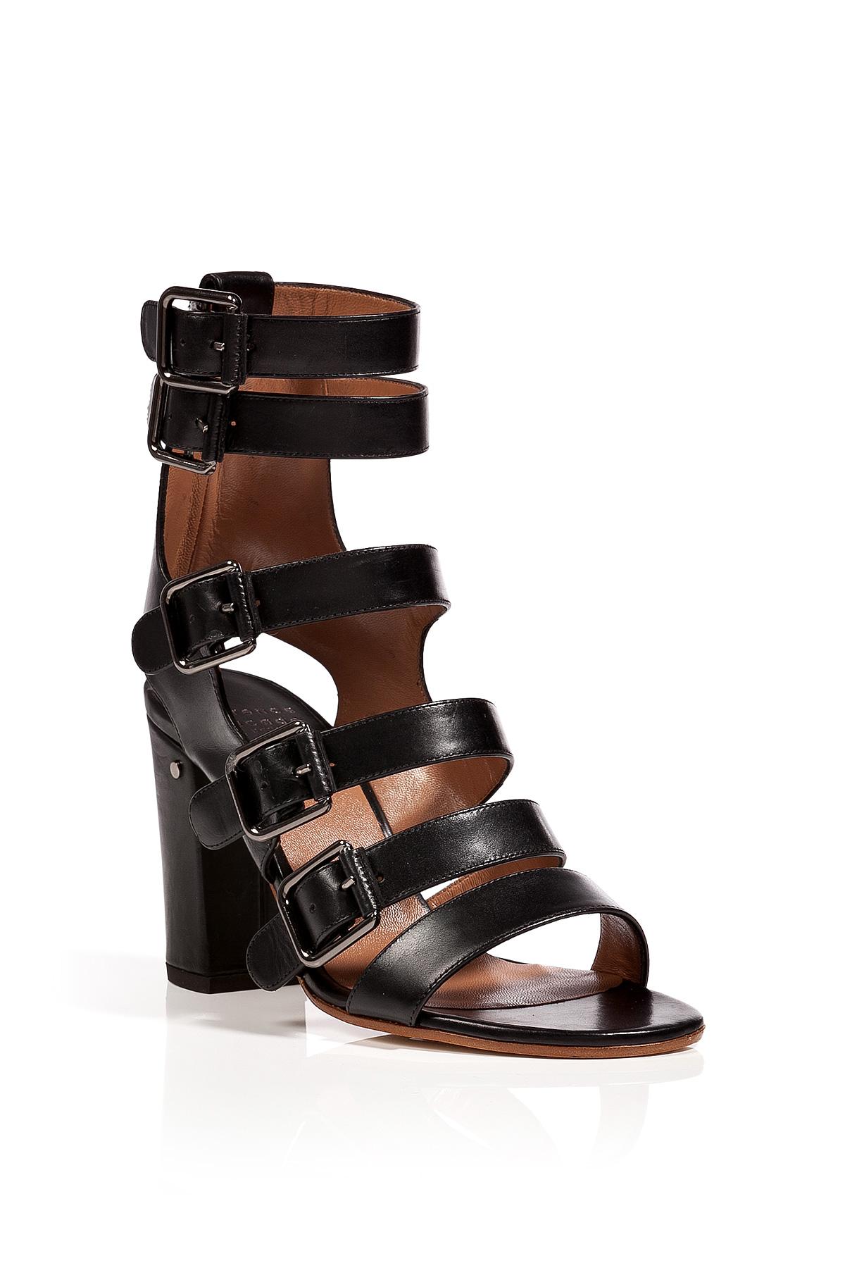 More Details Roger Vivier Mini Buckle Flat Strappy Sandals Details Roger Vivier leather sandals with signature buckle detail. Flat metal-trimmed heel. Flat metal-trimmed heel. Open toe.