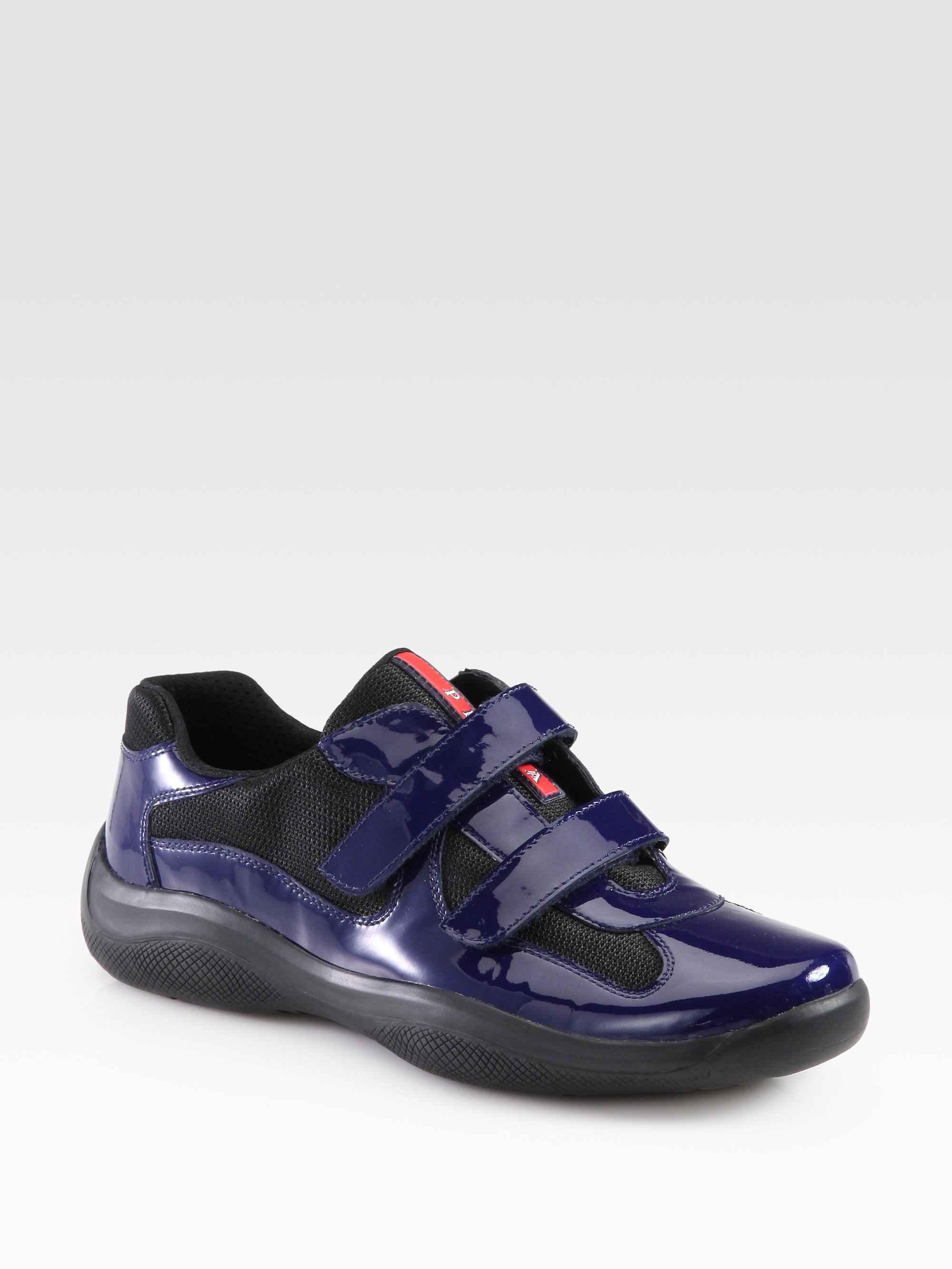 f31b5ab0b3f8b best price lyst prada double strap sneakers in blue for men a84fb ee242