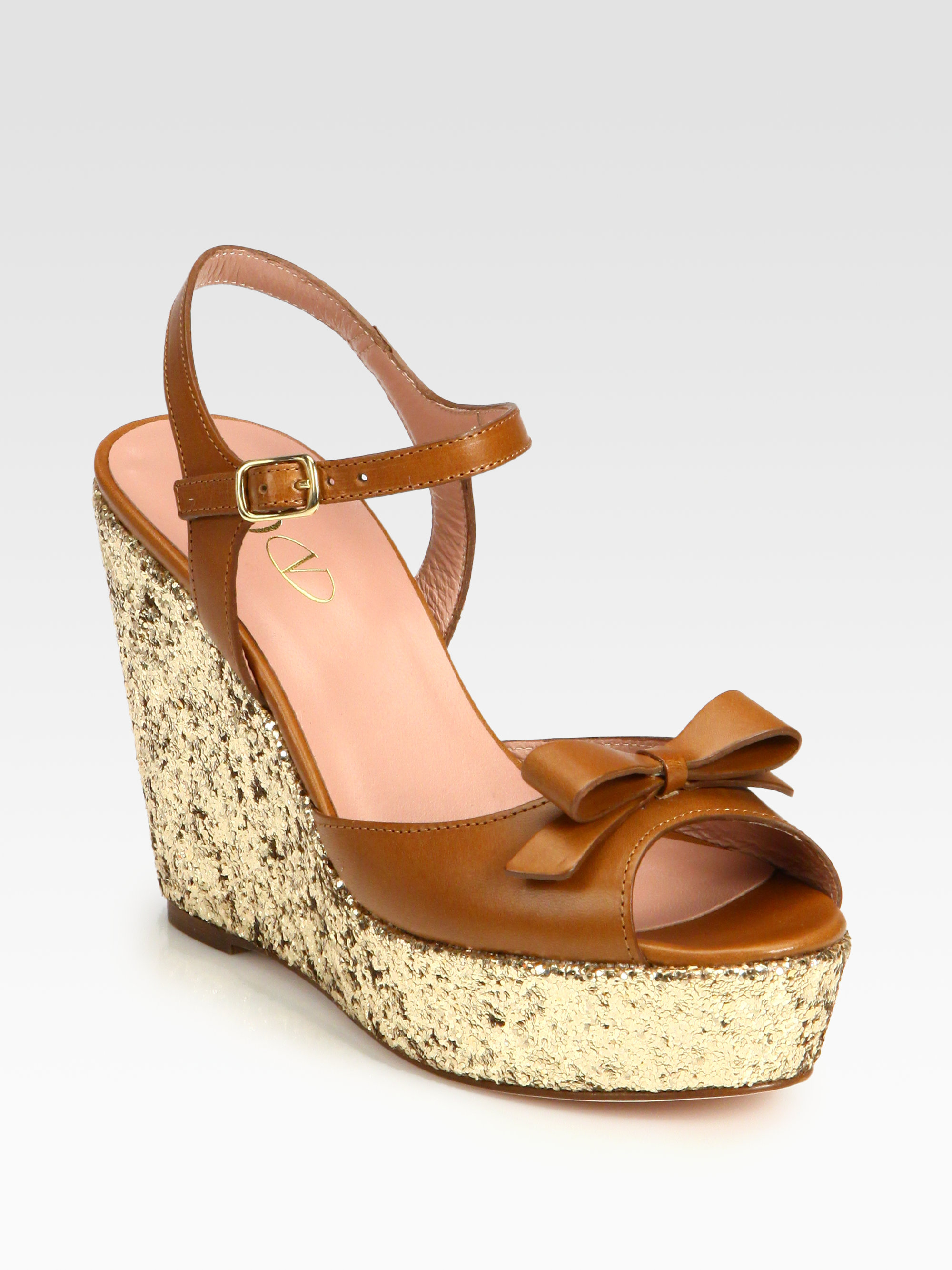 4d4d84fc6a4 Lyst - RED Valentino Leather Bow Glitter Wedge Sandals in Brown