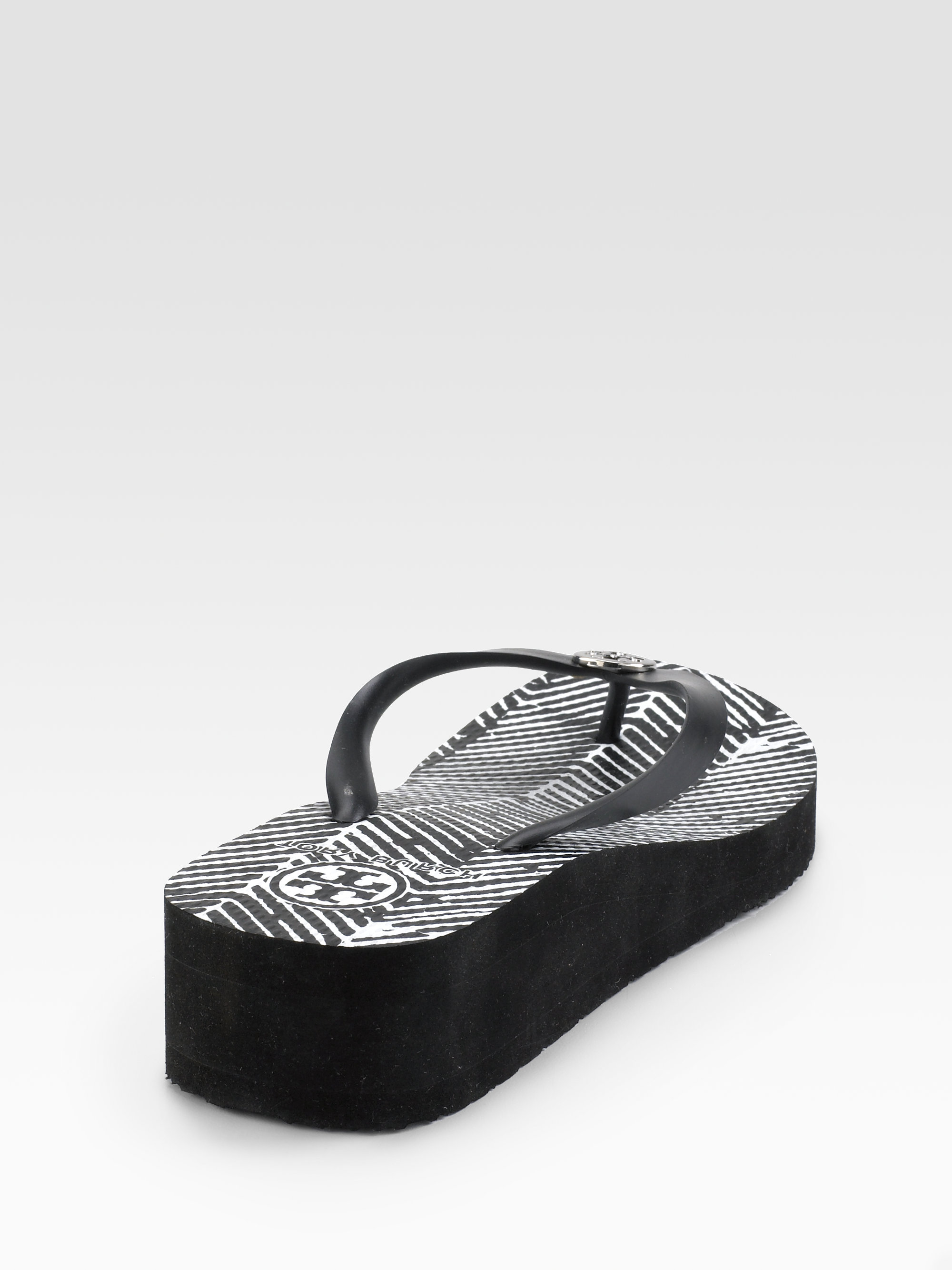 a08a8939f Lyst - Tory Burch Rubber Wedge Flip Flops in Black