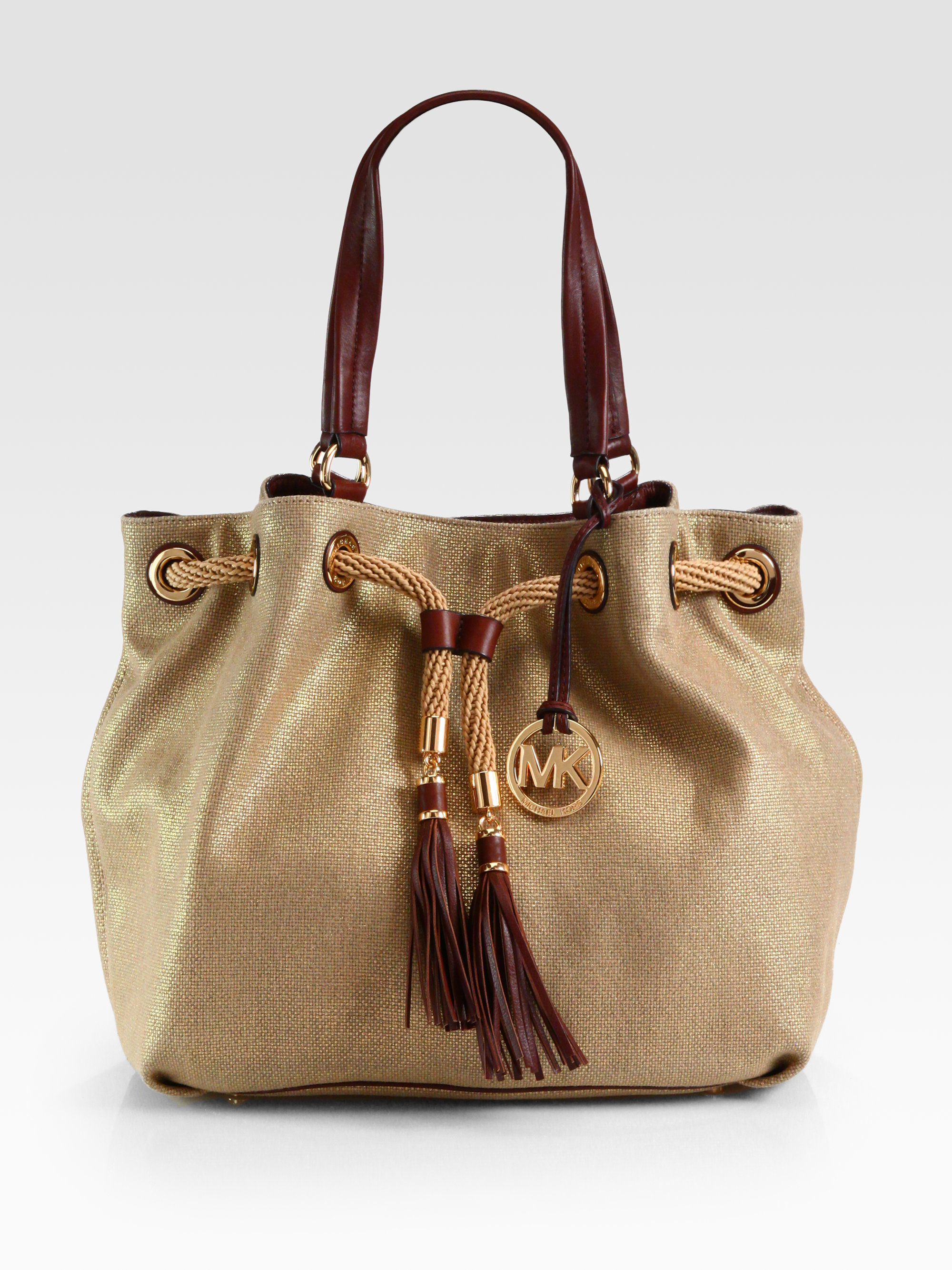 Michael michael kors Marina Metallic Canvas Drawstring Tote in ...