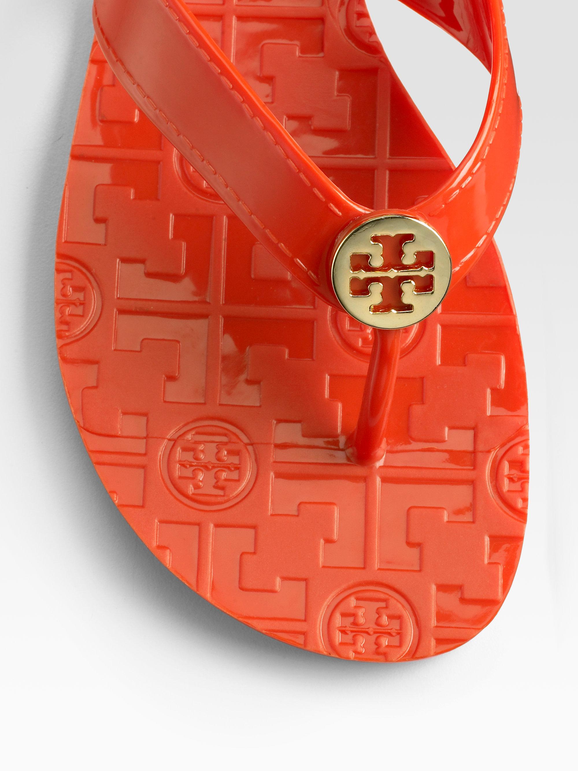 935aa5a6484b Lyst - Tory Burch Thora Jelly Flip Flops in Orange