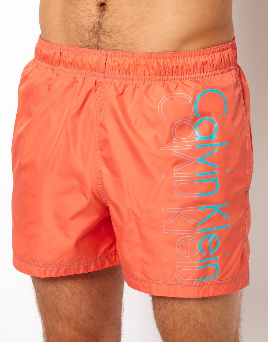 a7117e0f0fc Calvin Klein Placement Logo Swim Shorts in Orange for Men - Lyst