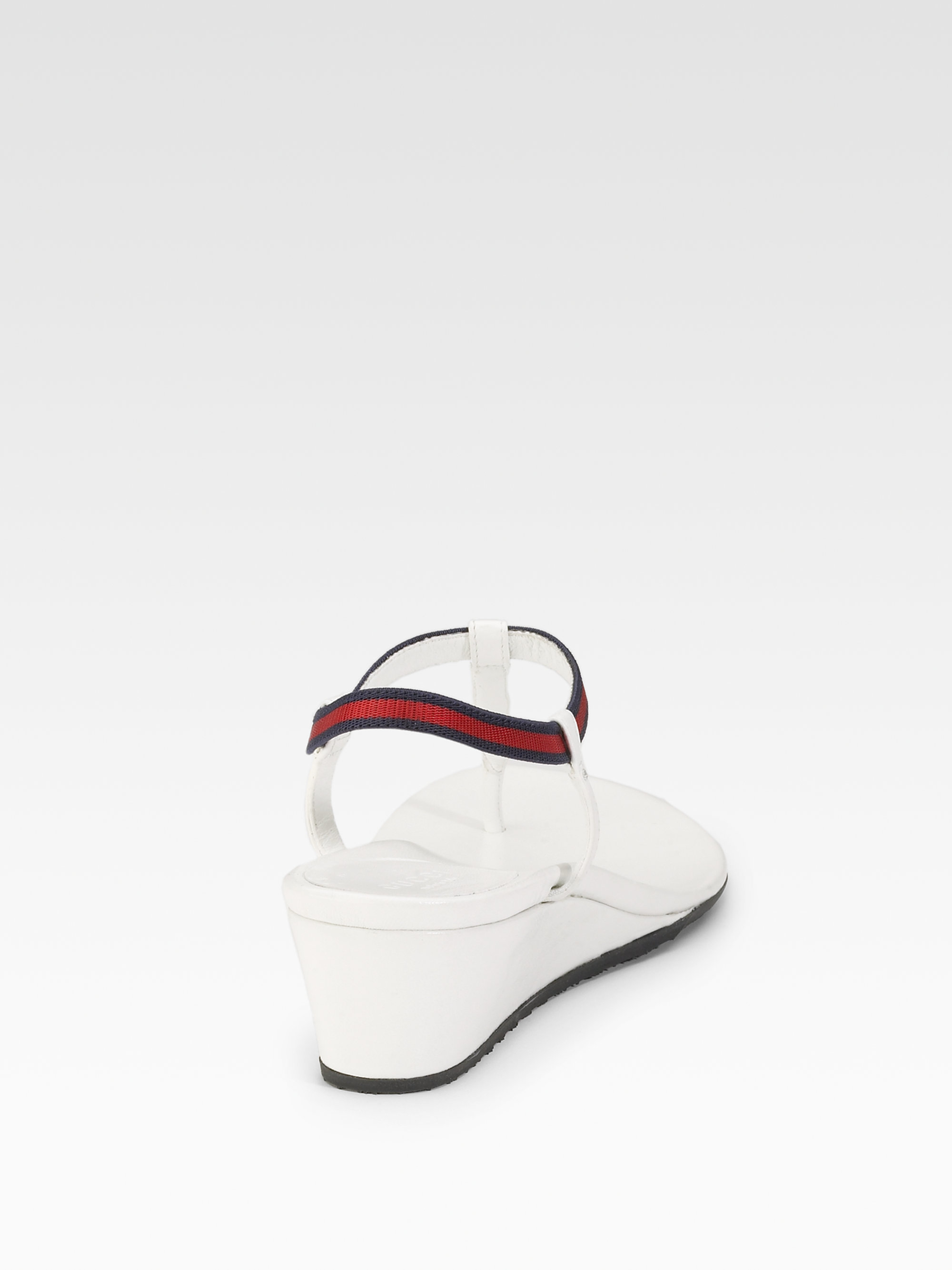 85f39f39f2a9 Lyst - Gucci Areia Thong Wedge Sandals in White
