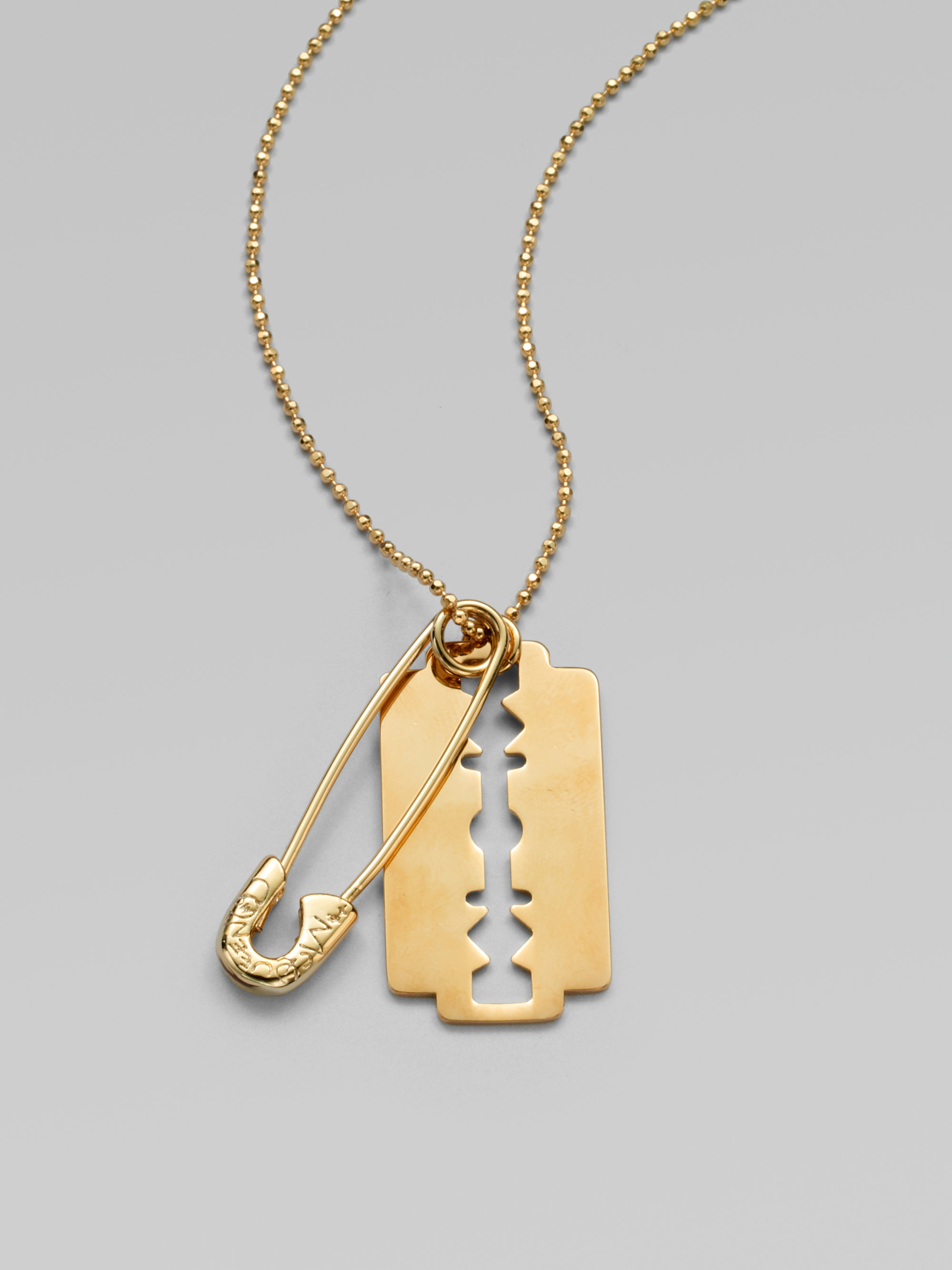 Lyst mcq razor blade pendant necklace in metallic gallery thecheapjerseys Image collections