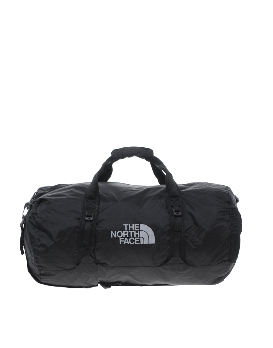 the north face flyweight duffle bag in black for men lyst. Black Bedroom Furniture Sets. Home Design Ideas