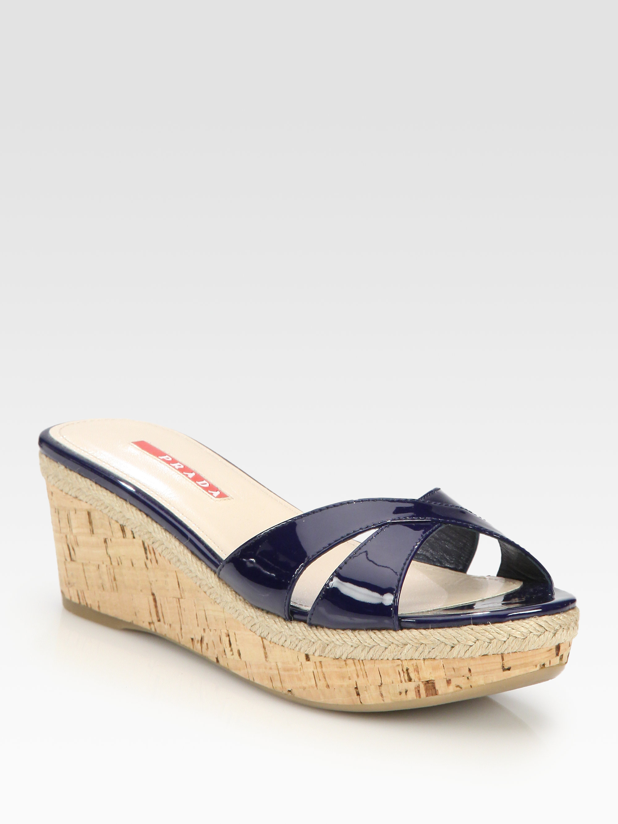 bee5273a180 Lyst - Prada Patent Leather Cork Wedge Slides in Blue
