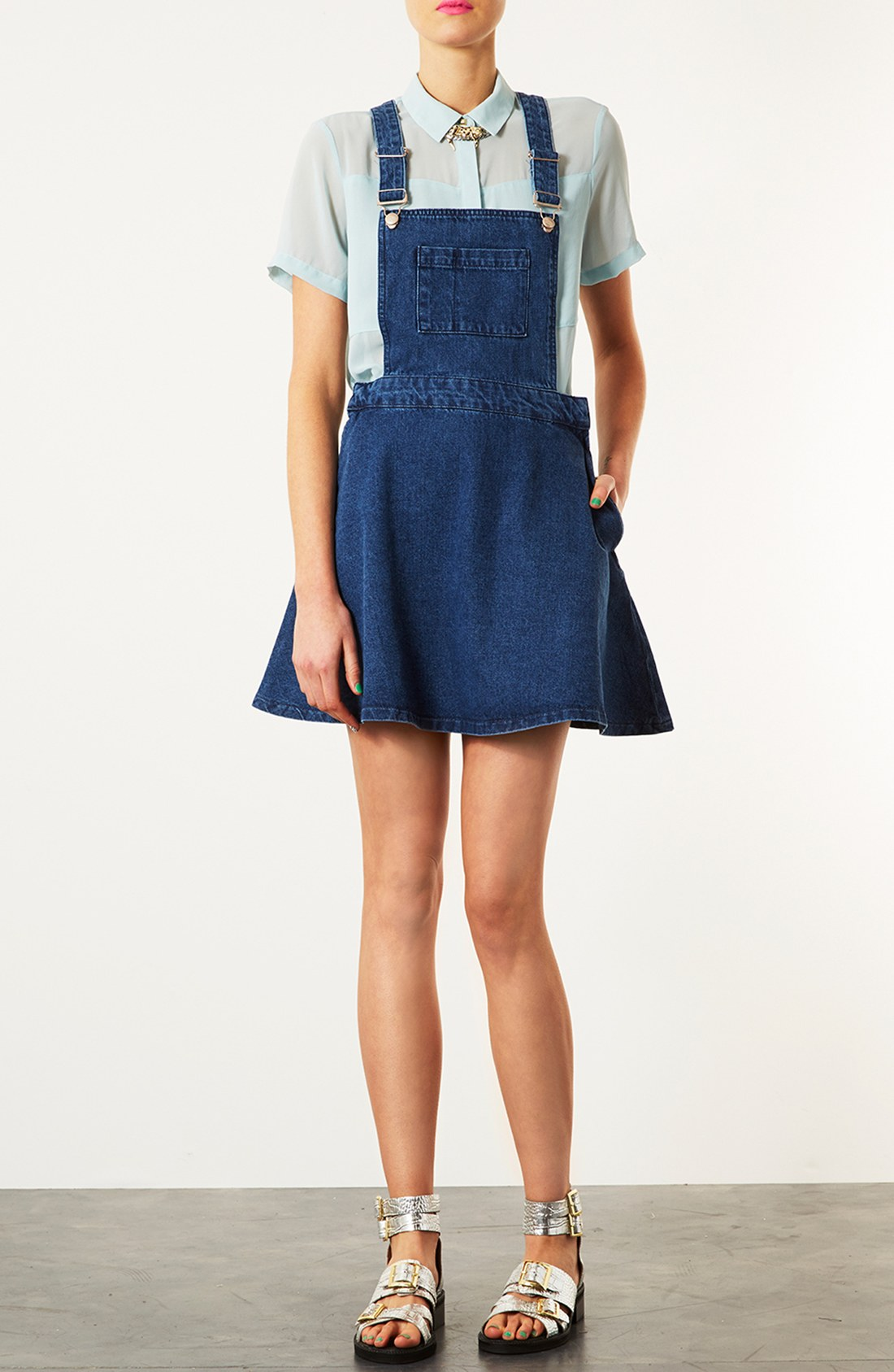 Denim Moto Dress - Cute denim dress in a sleek moto design. Exposed front zip pockets. Detachable buckle belt. 3/4 sleeves. Asymmetric front zip closure.