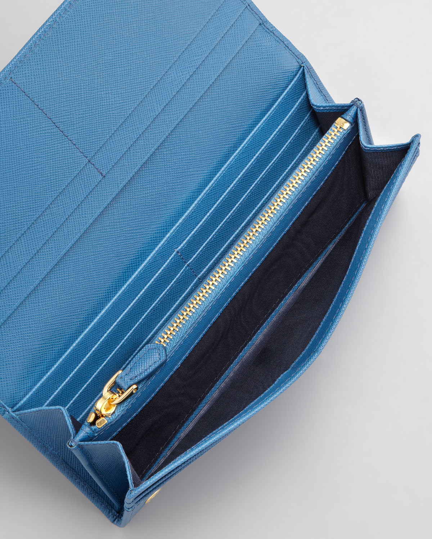 3c9d8ff0070f ... discount code for lyst prada saffiano triangle continental flap wallet  in blue 4b133 87406