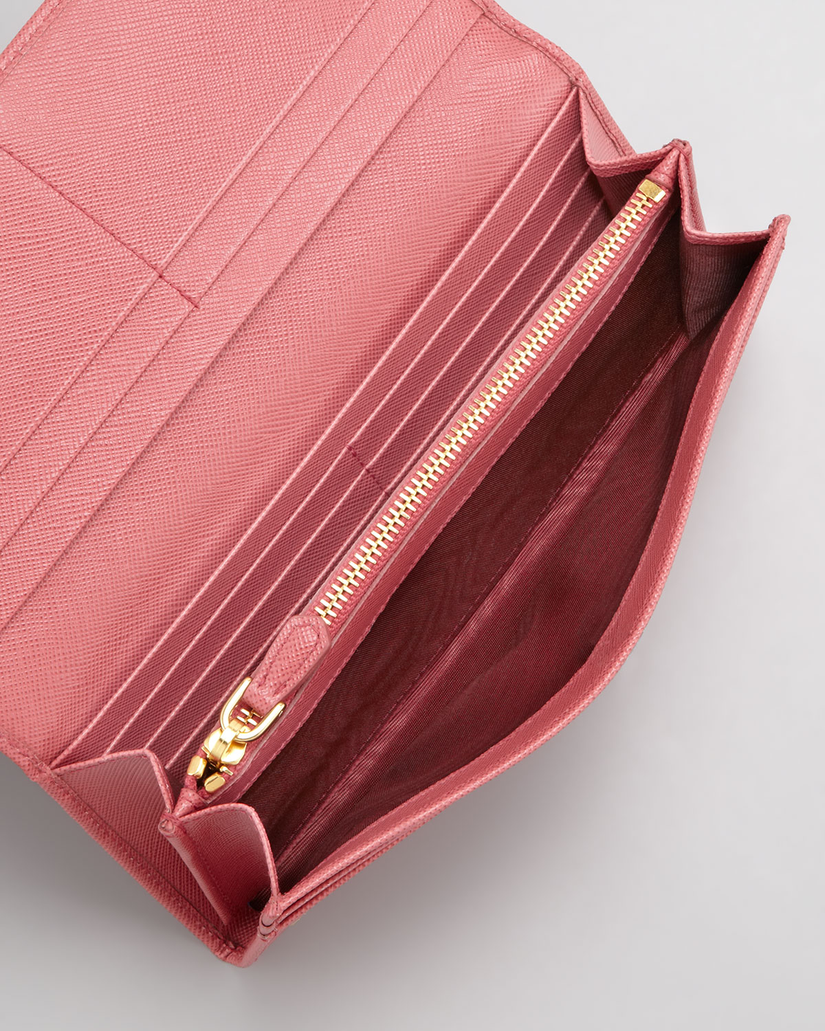fce787ea5962be Prada Saffiano Triangle Continental Flap Wallet in Pink - Lyst