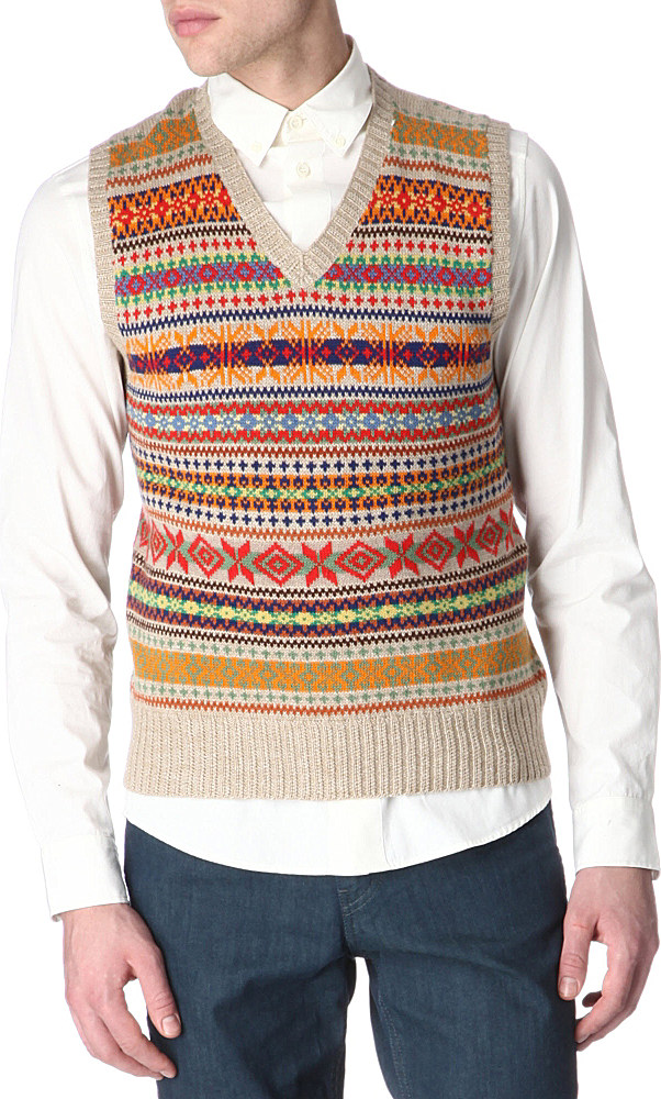 Vintage Men's Knitwear, Jumpers & Cardigans. Cosy up with Beyond Retro's range of men's vintage knitwear, jumpers and cardigans. Make like Biggie Smalls in the perfect 90s Coogi-style jumper or browse our range of Nordic and cable knits for a classic winter wardrobe staple that will stand the test of time.