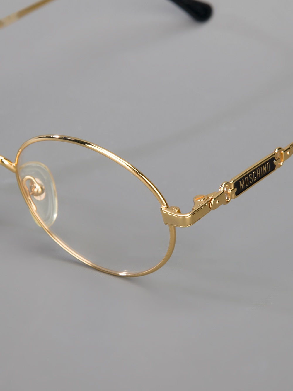 Gold Metal Glasses Frames : Moschino Round Frame Glasses in Metallic Lyst