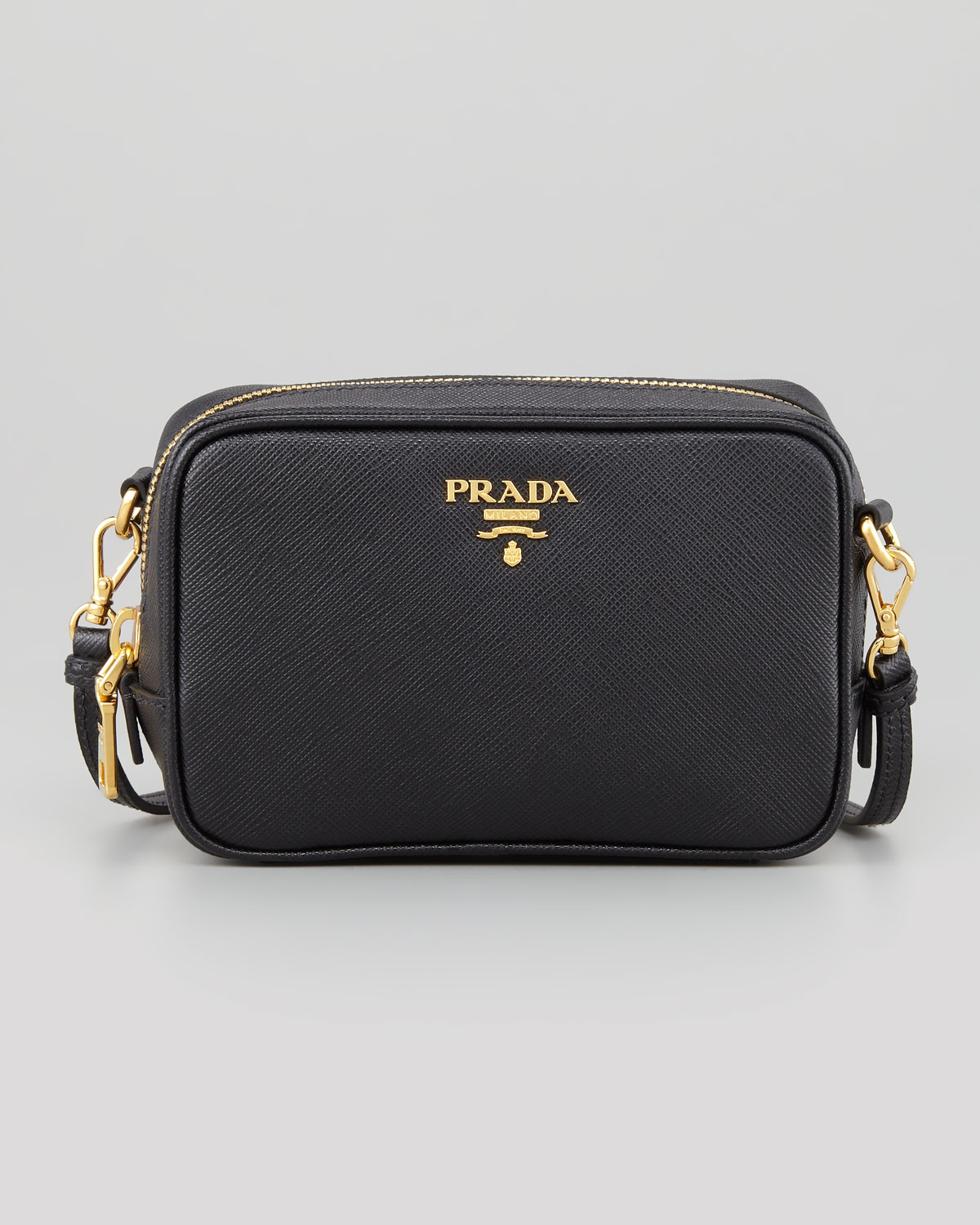 7490328b00d7 Prada Saffiano Mini Zip Crossbody Bag in Black - Lyst