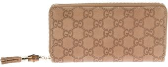 Gucci Logo Embossed Wallet - Lyst