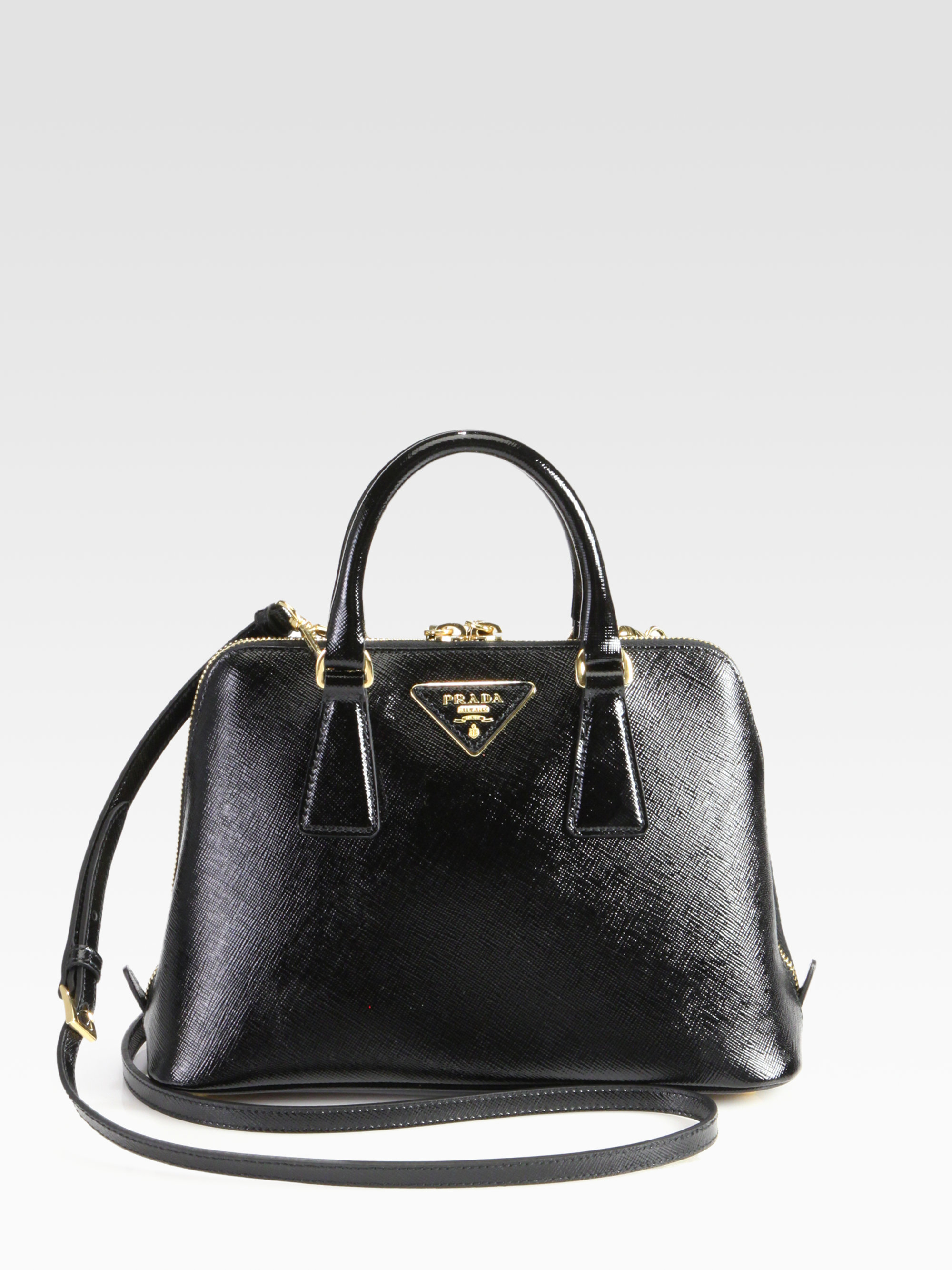 9cdf8451fe57 ... official store prada saffiano vernice small round top handle bag in black  lyst 7b139 0cc67