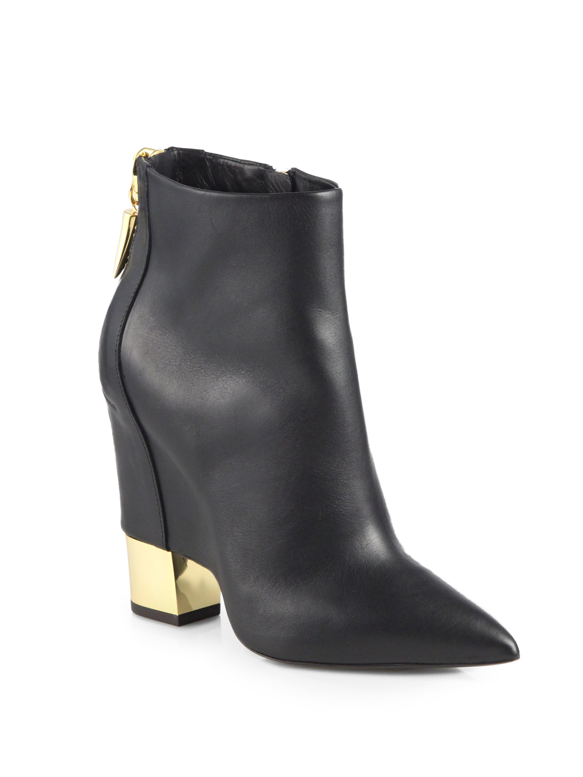 giuseppe zanotti leather cutout wedge ankle boots in black