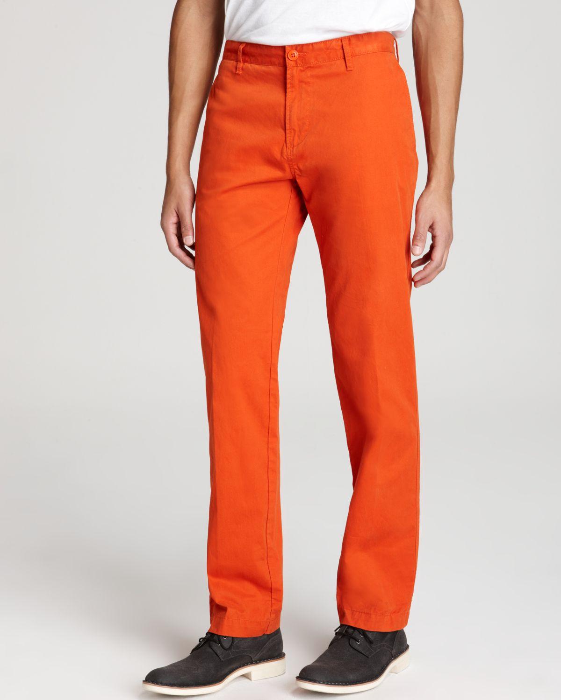 Lyst Lacoste Flat Front Slim Fit Pants In Orange For Men