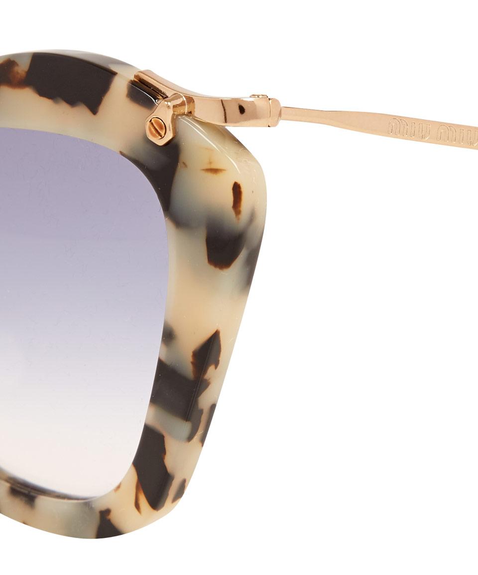 55c9b8b68ca Miu Miu Cat Eye Sunglasses Black And White