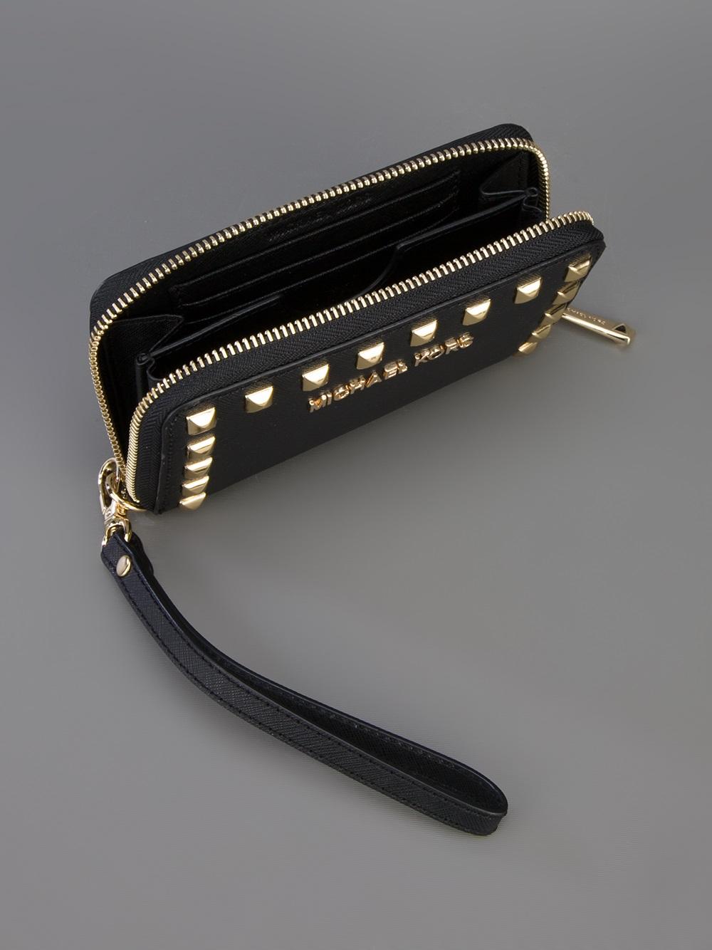 lyst michael kors studded wristlet wallet in black