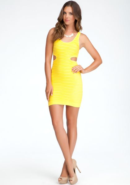 Bebe Side Cutout Bodycon Tank Dress In Yellow Dandelion