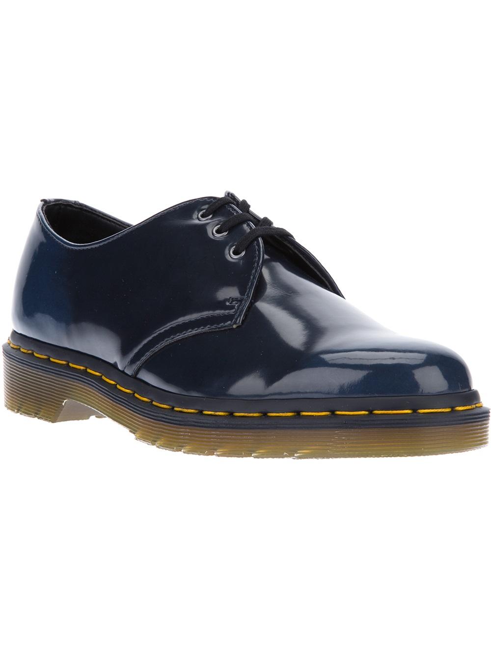 Shoe Brand With Yellow Stitching